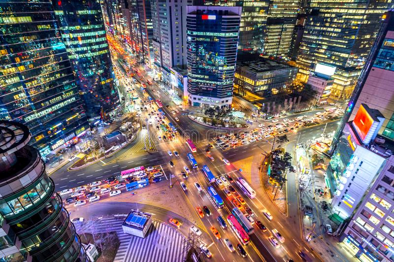 Traffic speeds through an intersection at night in Gangnam, Seoul in South Korea.  royalty free stock images