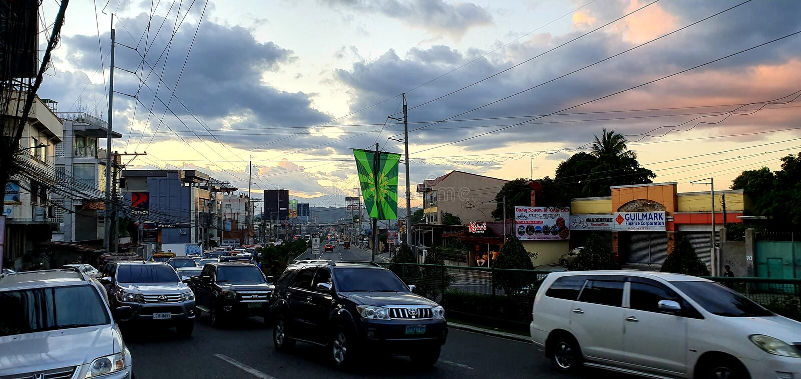 Traffic Starts To Build Up as the Sun Sets in Davao City, Philippines royalty free stock photography