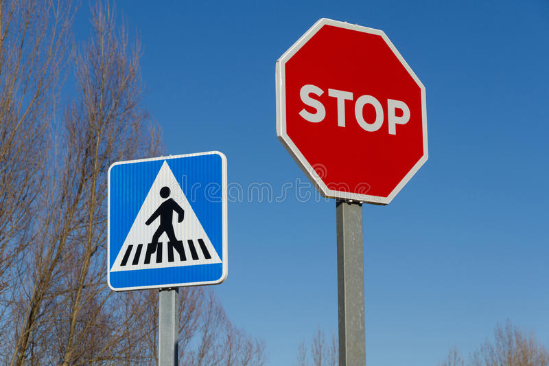 Traffic Stop Signs and Pedestrian Crossing. Two traffic signals: Pedestrian crossing or zebra crossing and Stop signal stock images