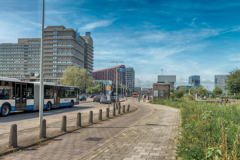 Traffic in streets of amsterdam, cars, bus, Bicycles, zuidas in Amsterdam, luxery apartments, living, houses, VU MC. Amsterdam, De Boelelaan, The Netherlands, 08 royalty free stock photography