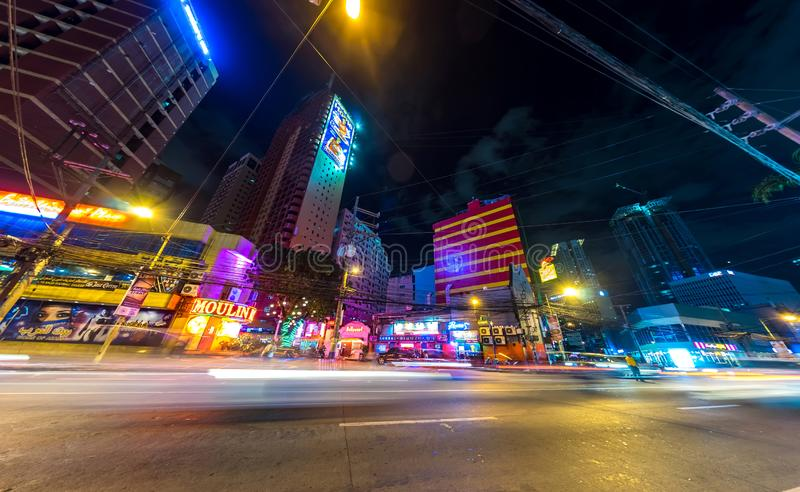 Traffic on the streets of Manila at night royalty free stock photo
