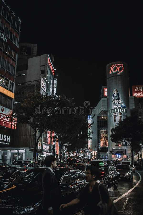 Traffic on streets of Tokyo, Japan at night stock images