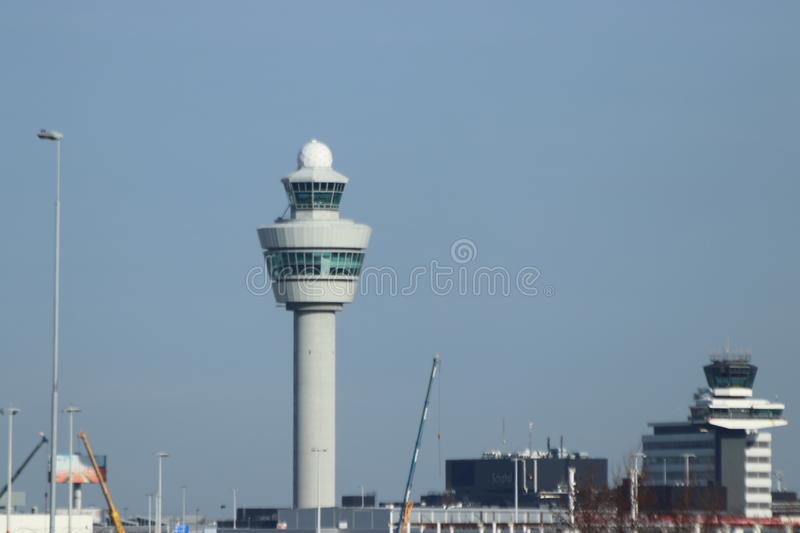 Traffic tower of amsterdam schiphol airport at the main terminal in the Netherlands royalty free stock photo