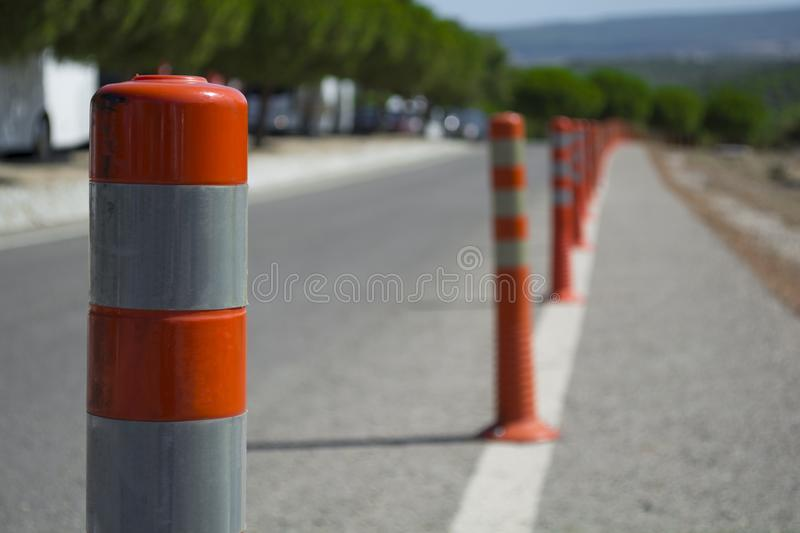 Traffic warning cone in row to separate route in road area.  royalty free stock photos