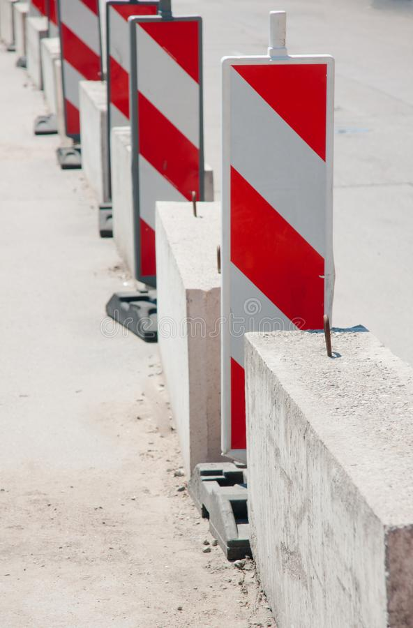 Traffic signs on the road. Traffic white and red signs on the road royalty free stock images