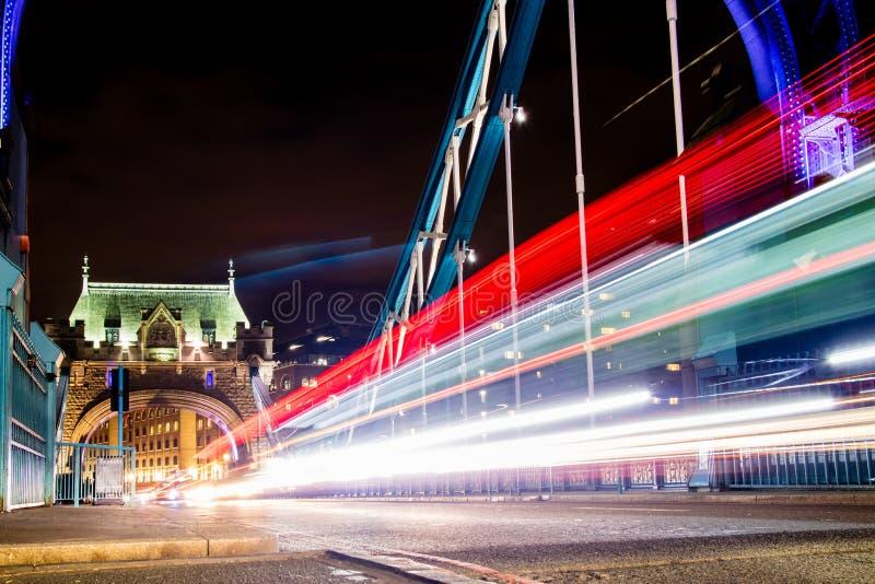Traffic Crossing Tower Bridge. Traffic whizzing across Tower Bridge in London, the UK royalty free stock photos
