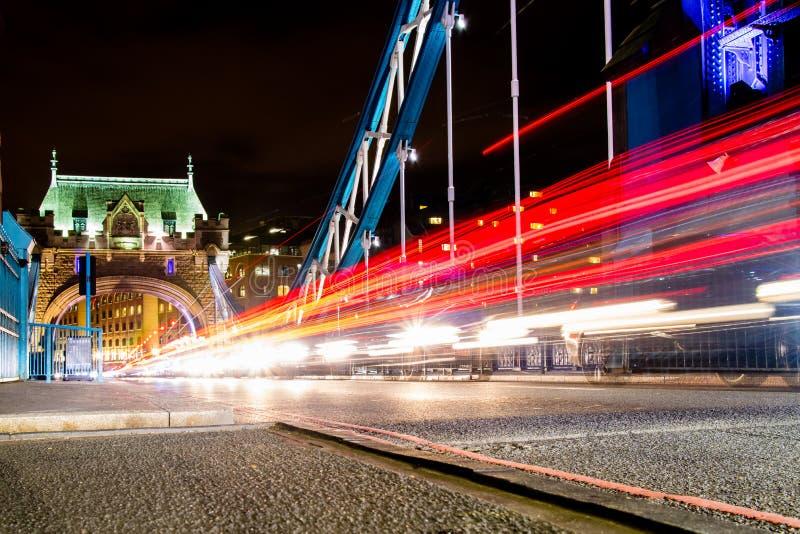 Traffic Crossing Tower Bridge. Traffic whizzing across Tower Bridge in London, the UK stock image