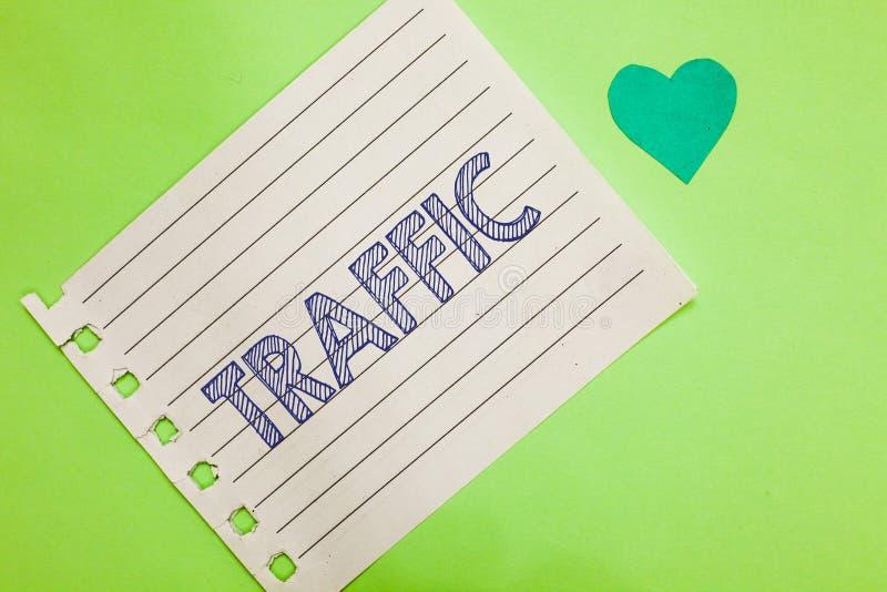 Traffico del testo di scrittura di parola Concetto di affari per i veicoli che si muovono sul taccuino di trasporto di moto dell' fotografia stock