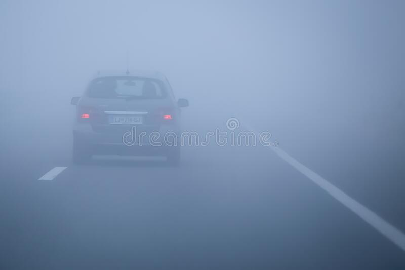 Traffico di nebbia fotografia stock