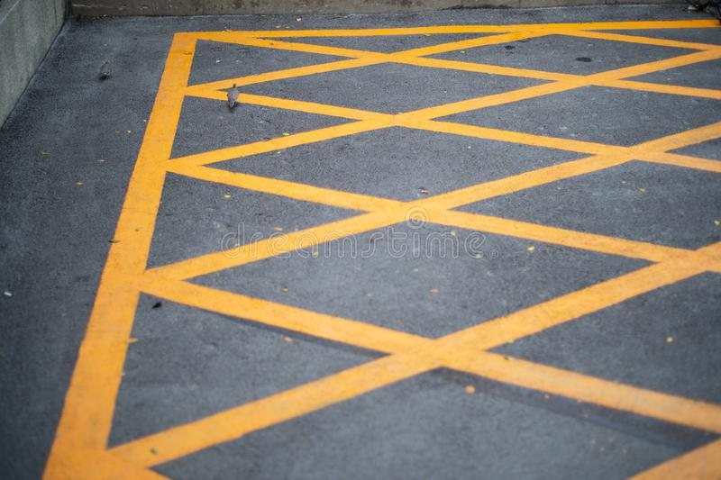 Trafic yellow line on the road, sign on street.  stock image