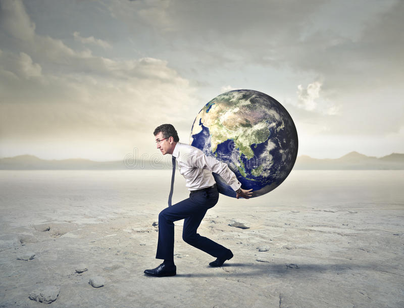 Tragen des Gewichts der Welt stockfotos