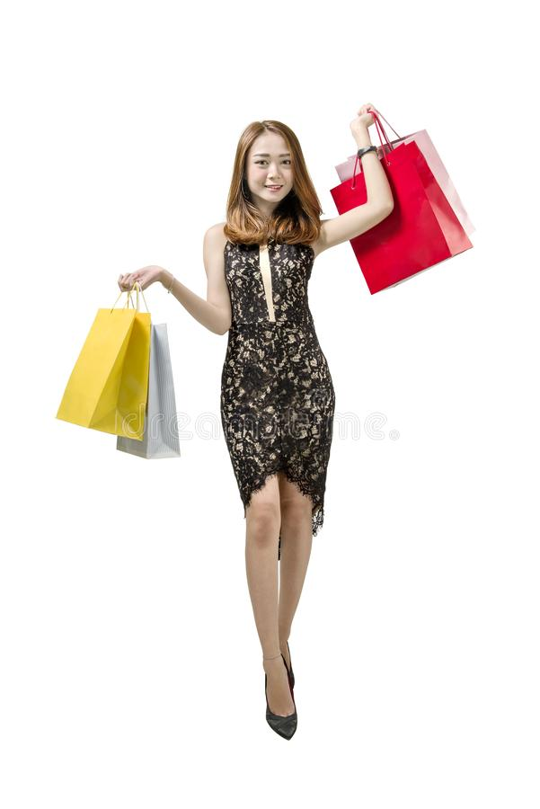 Tragende Einkaufstascheaufstellung der glücklichen asiatischen Frau stockbilder