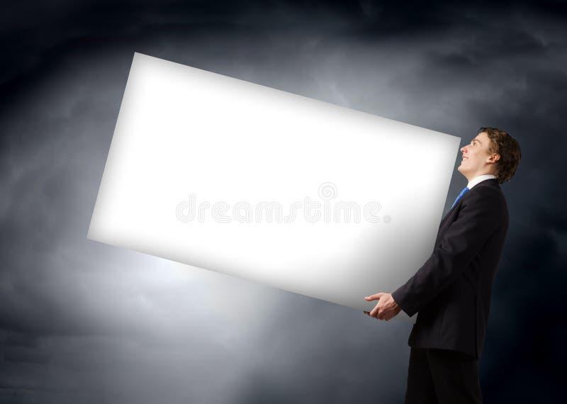Tragende Fahne des Mannes stockfoto