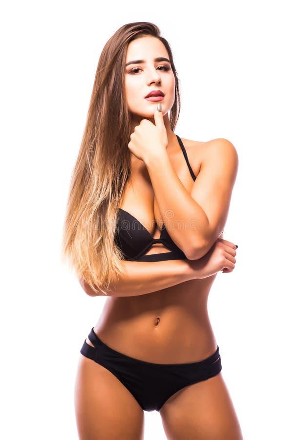 Tragende schwarze Badebekleidung der Marine der sexy Frau, die auf weißem Hintergrund aufwirft lizenzfreie stockbilder