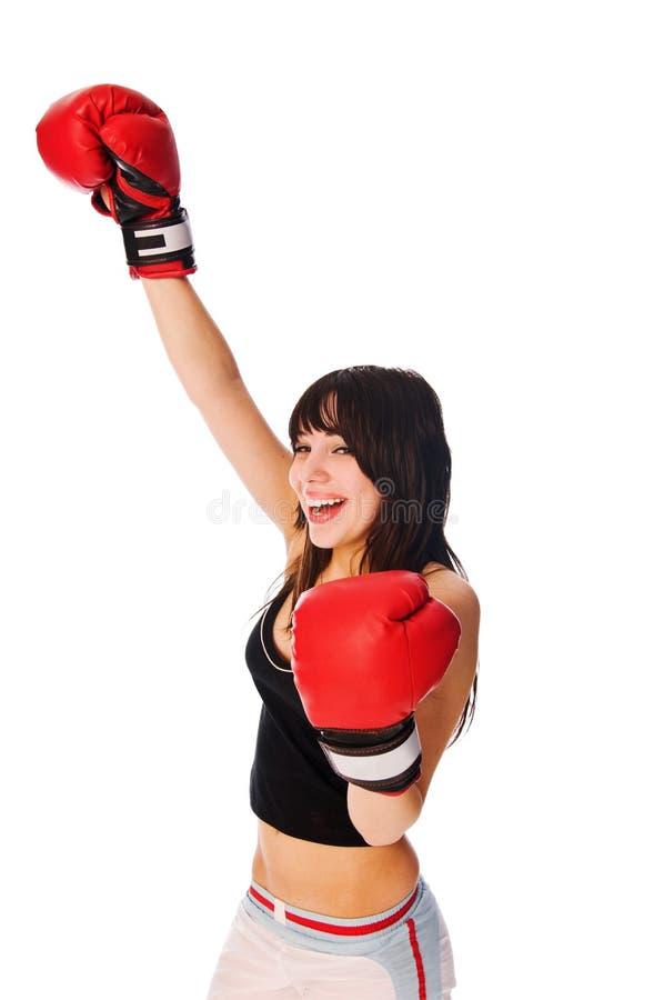 Tragende Verpackenhandschuhe des Mädchens mit einer rised Hand stockbilder