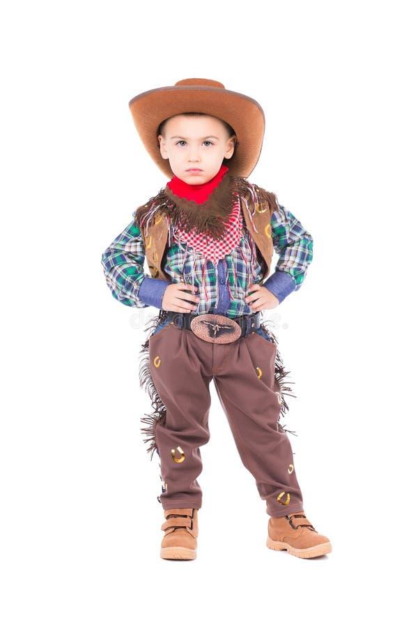 Tragender Cowboyanzug des kleinen Jungen stockfoto