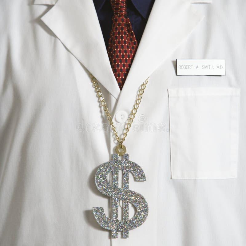 Tragendes Dollarzeichen des Doktors. stockfoto