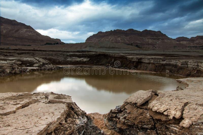 Trago-agujero En El Mar Muerto Imágenes de archivo libres de regalías