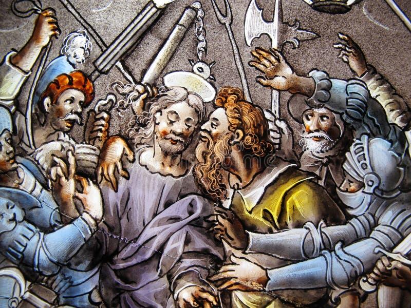 Traición de Cristo por la ventana de cristal manchada de Judas imagen de archivo libre de regalías