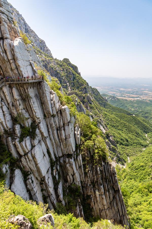 Trail and cliffs in Songshan Mountain, Dengfeng, China. Songshan is the tallest of the 5 sacred mountains of China. Dedicated to Taoism and stand above the royalty free stock images