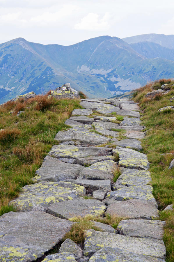Trail disappear in high mountains. Rock trail disappear in high mountains ridge stock photography