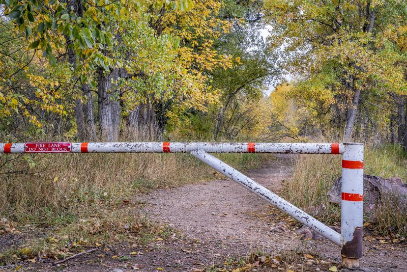 Trail and fire road with a gate royalty free stock photos