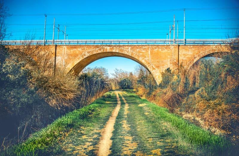 Trail foot path urban colour jog under straight bridge urban stock photography