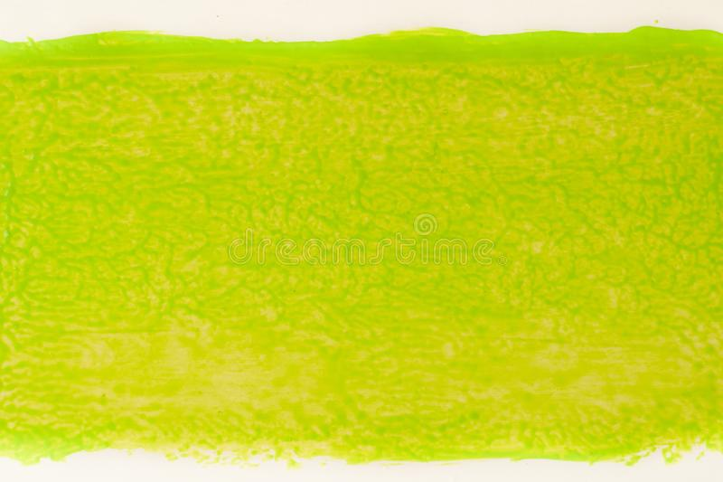 Trail of green paint from roll for painting on wall. Repair concept royalty free stock photography