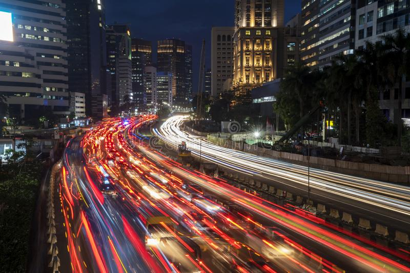 Trail lights from rush traffic at night time. Top view of trail lights from rush traffic on the road at night time in Jakarta downtown royalty free stock image