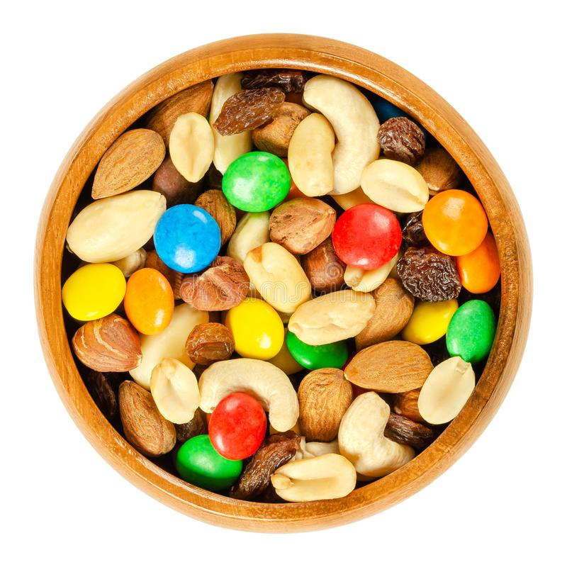 Trail mix in wooden bowl over white royalty free stock images