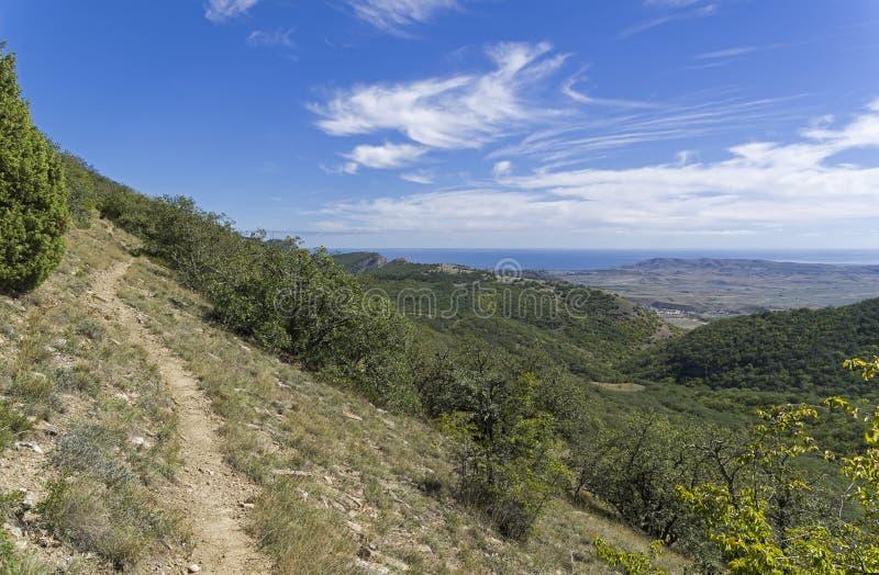 Trail on the mountainside. Tokluk mountain range, Crimea. Sunny day in September stock images