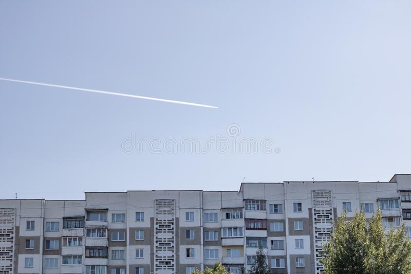 The Building And Trace Of Airplane In Sky Stock Image