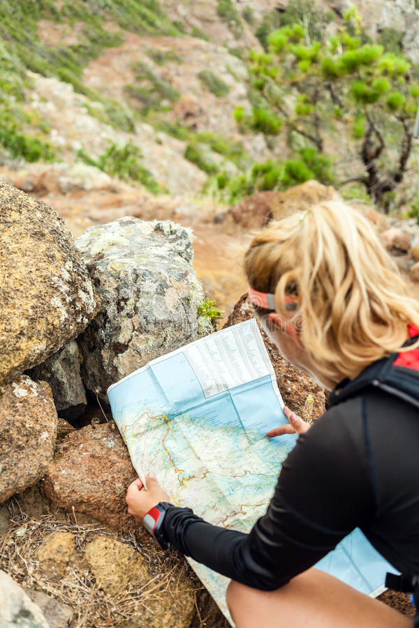 Trail runner checking map royalty free stock images
