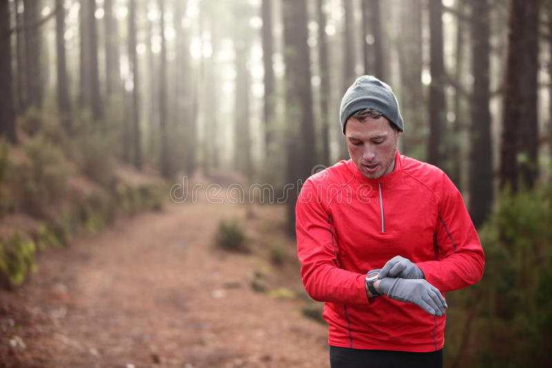 Trail Runner Looking At Heart Rate Monitor Watch Stock Image