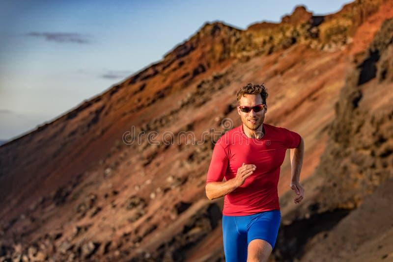 Trail runner on mountain run. Athlete man focused running training endurance. Fitness motivation royalty free stock image