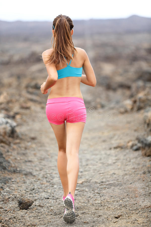 Trail runner woman running cross-country run stock photography
