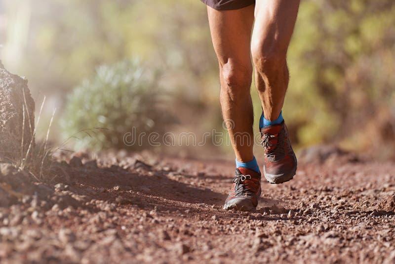 Trail running man stock photo