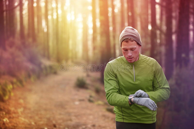 Trail running runner heart rate monitor watch stock photography