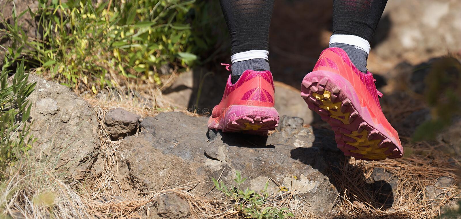 Trail running woman on mountain path royalty free stock photos