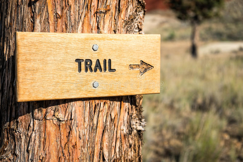 Trail Sign With Arrow in a National Monument. Directional trail sign with arrow pointing the way in a national monument. The Painted Hills Unit of John Day stock photos