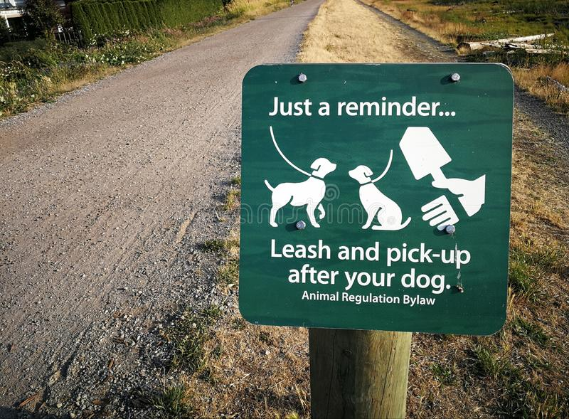 Trail sign: Leash and pick up after your dog. Trail sign: leash and pick up a royalty free stock photos