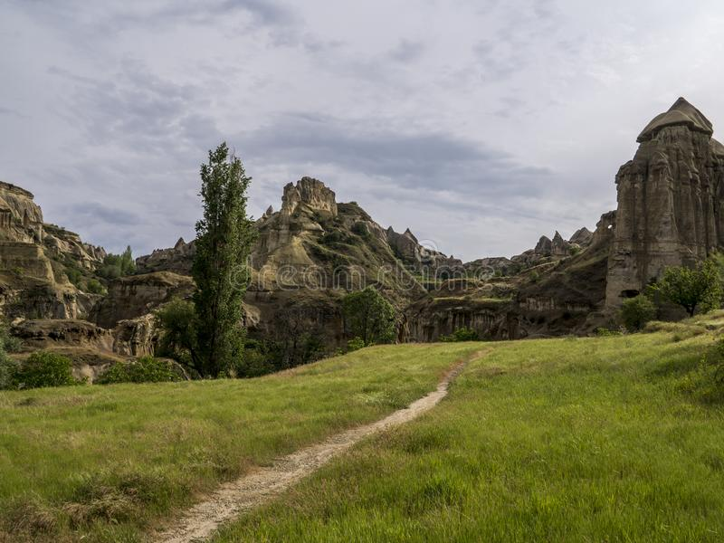 Trail to Cave house of Fairy Chimneys rocks mushroom in Pasabag, Monks Valley, Cappadocia, Turkey. royalty free stock photos