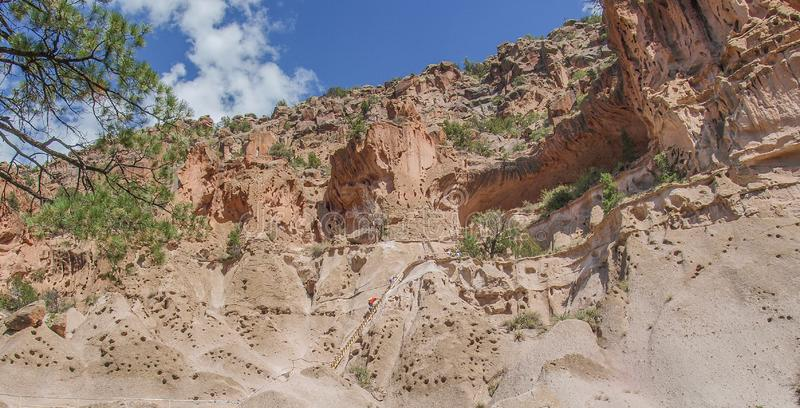 Trail to Ceremonial Cave in Bandelier National Monument. A trail leads hikers up pole ladders to reach the ceremonial cave in Frijoles Canyon Native American stock images