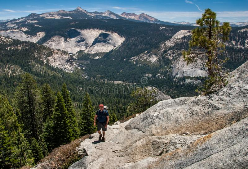Hiker On the trail to Half Dome, Yosemite royalty free stock image