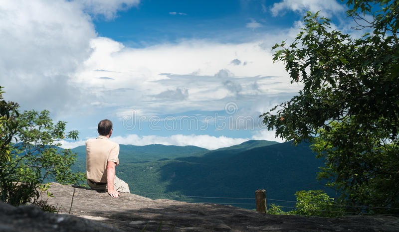 Trail to summit of Whiteside Mountain. Senior man looking at view from the trail to the summit of Whiteside Mountain near Highlands and Cashiers in North stock image