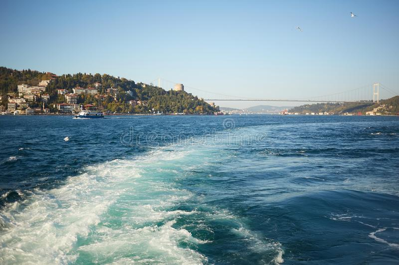 Trail on water surface behind of fast moving motor boat stock images