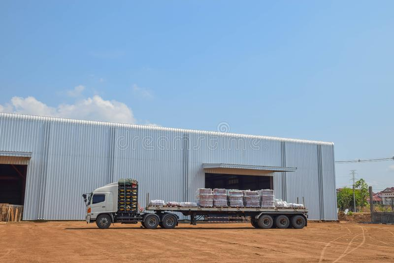 Trailer cargo truck at the warehouse, warehouse, stock, stockpile, storehouse building with the blue sky cloud background stock images