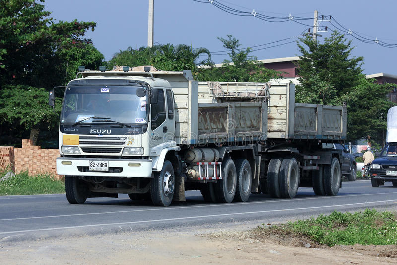 Trailer dump truck. CHIANGMAI, THAILAND - OCTOBER 18 2014: Trailer dump truck of Chiangmai Concrete product company, CCP. Photo at road no 121 about 8 km from royalty free stock photography