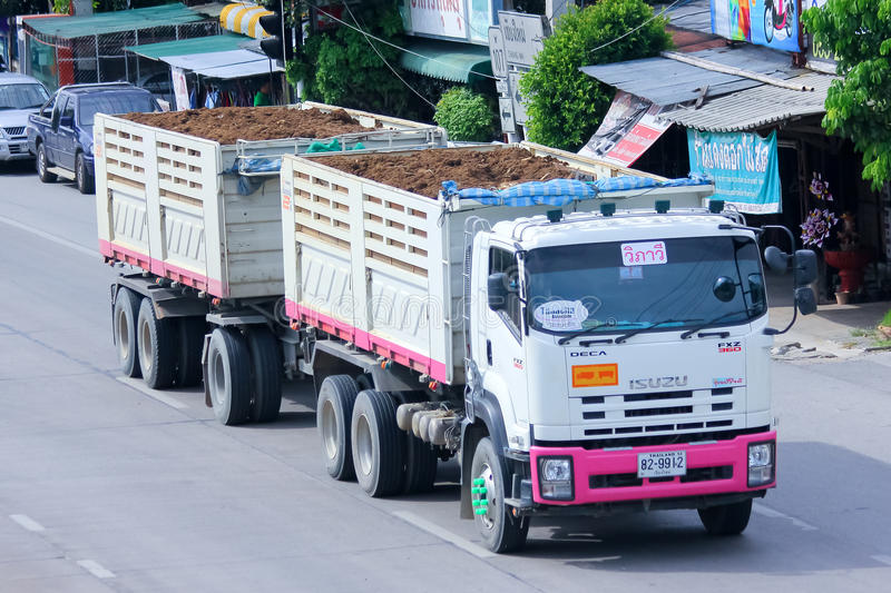 Trailer dump truck of Tanachai company. CHIANGMAI, THAILAND - JULY 4 2014 : Trailer dump truck of Tanachai company. Photo at road no 107, About 8 Km from royalty free stock photography