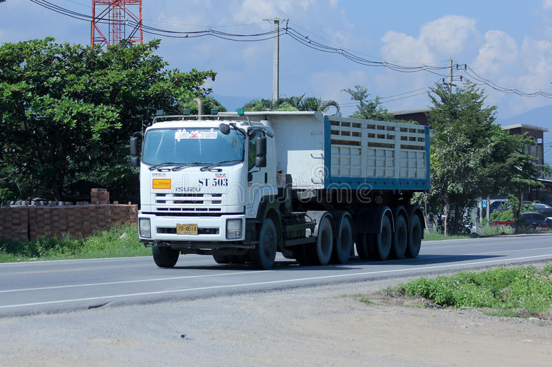 Trailer dump truck of Yoonsila Company. CHIANGMAI, THAILAND - NOVEMBER 11 2014: Trailer dump truck of Yoonsila Company. Photo at road no.121 about 8 km from royalty free stock photo